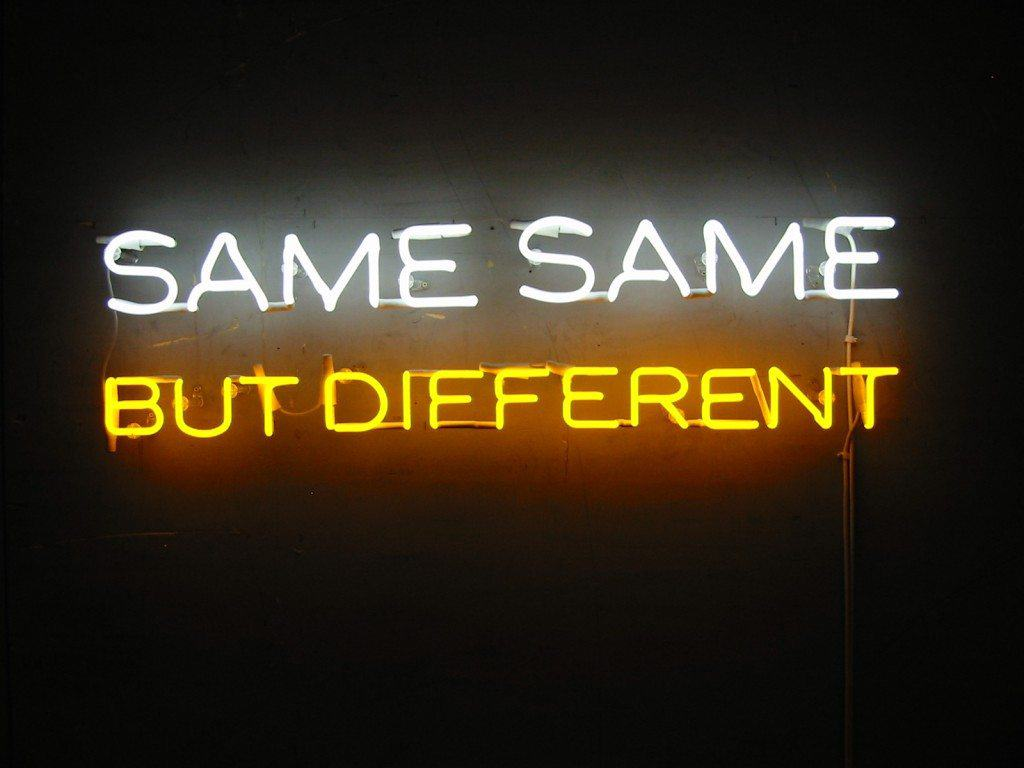 a neon sign showing same same but different