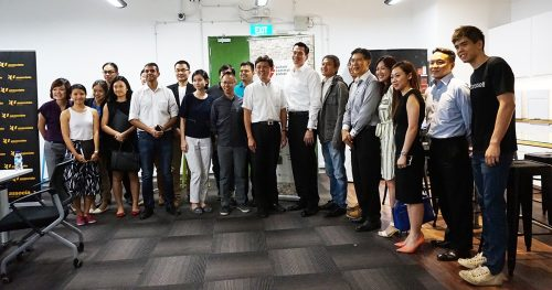 Chan Chun Sing taking photos with people from the startup community in Singapore