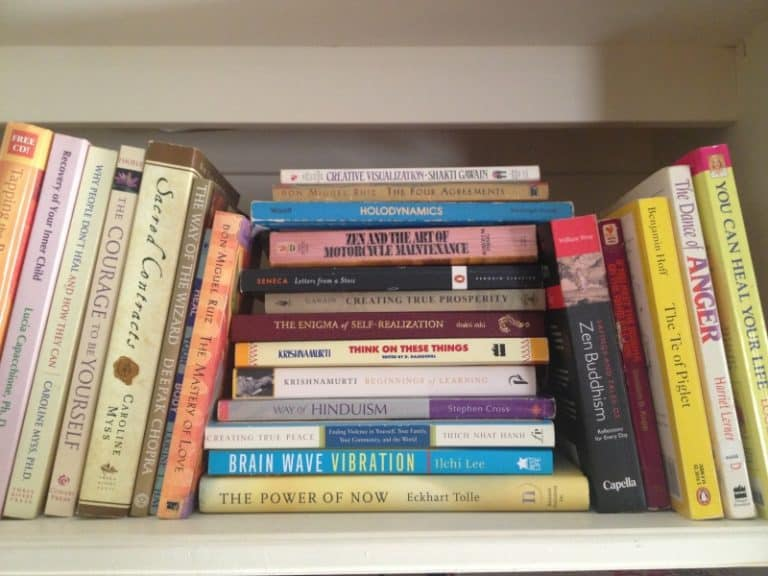 stacks of self-help books on a shelf