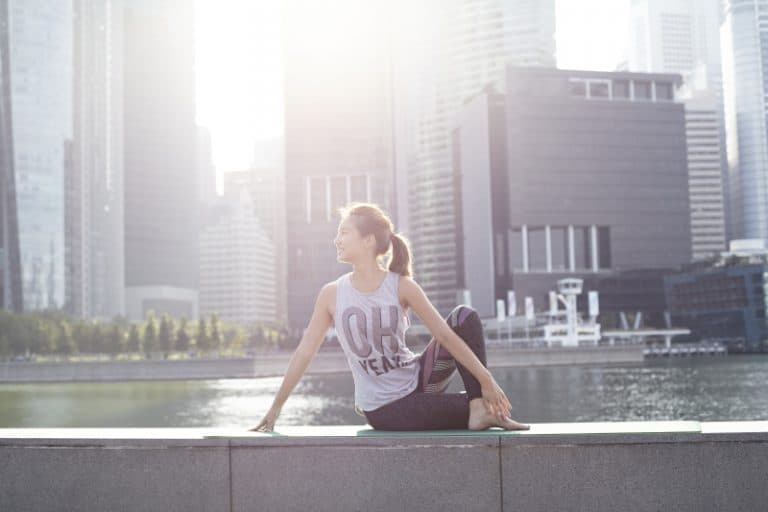 Melissa yoga pose in front of Marina Bay